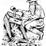 A gold miner using a cradle